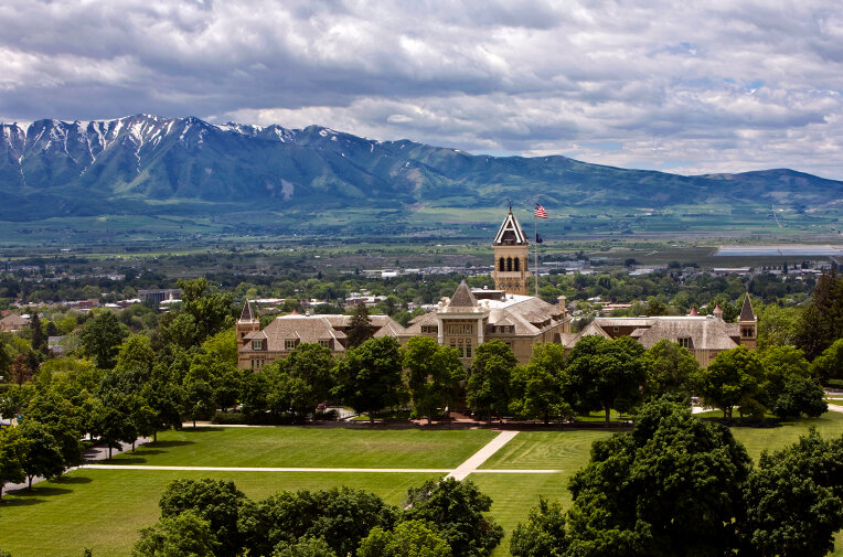 Utah State University with Wellsville mountain range in the background
